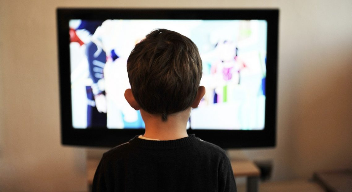 How does 'binge-watching' affect the way we enjoy TV?