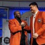 Shaq is the only one tall enough to put on Yao Ming's jacket.