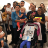 Holding their kids, activists walk out on Senate hearing in protest of migrant child detention