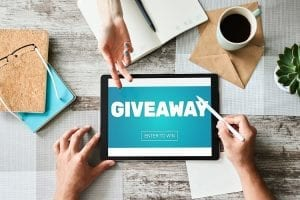 Giveaway, enter to win text on screen. Lottery and prizes. Social media marketing and advertising concept.